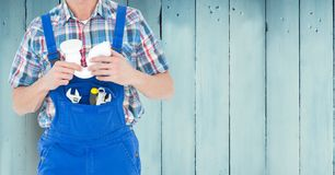 Handy man with tools standing against wooden background Stock Images