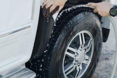 Handy man washing car by himself.  Royalty Free Stock Photography