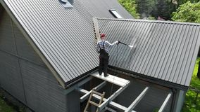 Handy man washing roof with high pressure stock video