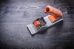 Handy mini woodworking vintage plane on wooden board Royalty Free Stock Image