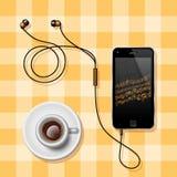 Handy mit den Kopfhörern und einer Kaffeetasse Lizenzfreie Stockbilder