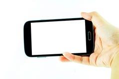 Handy mit mit Berührungseingabe Bildschirm in der weiblichen Hand auf weißem Hintergrund Lizenzfreie Stockfotos