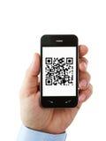 Handy mit QR Code auf dem Bildschirm stockfotografie