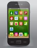 Handy mit Weihnachtsikonen Lizenzfreies Stockbild