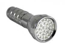Handy torch with LED. On white background royalty free stock photo
