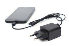 Handy- und Adapterladegerät Stockbilder