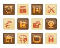 Handy- und Computerikonen über braunem Hintergrund lizenzfreie stockfotografie