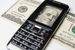 Handy und Geld Lizenzfreie Stockbilder