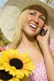 Handy und Sonnenblumen Stockbilder