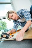 Handy woman installing wooden floor home royalty free stock photos