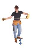A handy woman measuring for work. Stock Photos