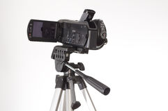Handycam tripod. Handycam and tripod on white background Royalty Free Stock Images