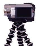 Handycam videocamera with black LCD on tripod Stock Photography