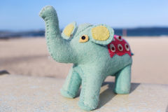 Handycraft elephant near beach Royalty Free Stock Images