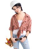 Handygirl. Beautiful young craftsperson wearing a tool belt an an hardhat stock images