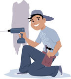 Handyman με ένα ηλεκτρικό τρυπάνι Στοκ Φωτογραφία