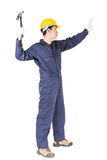 Handyman σε ομοιόμορφο με το σφυρί του Στοκ εικόνα με δικαίωμα ελεύθερης χρήσης