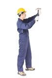 Handyman σε ομοιόμορφο με το σφυρί του Στοκ εικόνες με δικαίωμα ελεύθερης χρήσης
