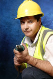 Handyman. The handyman can! Worker with drill on blue and black background. Peruse more of my people at work royalty free stock images