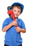 Handyman. Boy with hard-hat on holding a wrench over his shoulder, isolated on a white background stock photo