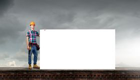 Handyman with banner Stock Photo