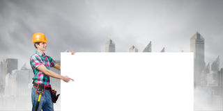 Handyman with banner Royalty Free Stock Photo