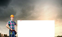 Handyman with banner Royalty Free Stock Photography