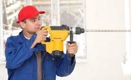 Handyman with big drill Royalty Free Stock Image