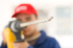 Handyman with big drill Royalty Free Stock Photography