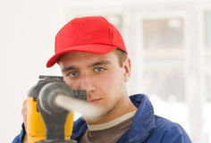 Handyman with big drill Royalty Free Stock Images