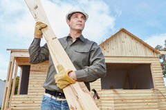 Handyman building woodhouse. Handyman building vacation woodhouse as DIY project Stock Photography