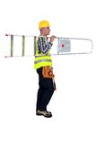 Handyman carrying a ladder. Stock Photo