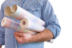 Handyman carrying rolls of wallpaper Royalty Free Stock Photos