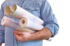 Handyman carrying rolls of wallpaper Royalty Free Stock Photos