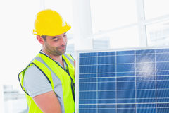 Handyman carrying solar panel at office Royalty Free Stock Photography