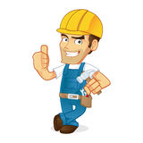 Handyman leaning and giving thumb up Stock Photo