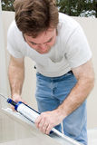 Handyman Caulking Stock Photography