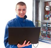 Handyman working with laptop Stock Photo