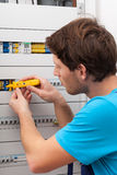 Handyman checking voltage Royalty Free Stock Image