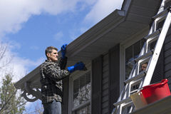 Handyman Cleaning Vinyl Home Exterior Stock Photography