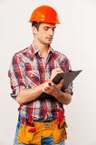 Handyman with clipboard. Royalty Free Stock Photos