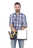 Handyman with clipboard Stock Images