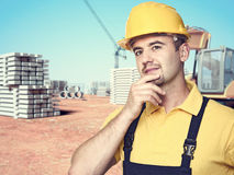 Handyman at construction site Royalty Free Stock Images