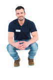 Handyman crouching Stock Image