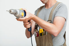 Handyman with drill Royalty Free Stock Image