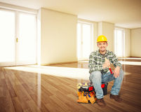 Handyman in empty house Royalty Free Stock Photos