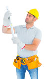 Handyman examining spirit level Stock Photo