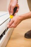 Handyman fixing an air conditioning Royalty Free Stock Photos