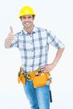 Handyman gesturing thumbs up sign. Portrait of happy handyman gesturing thumbs up sign over white background Stock Images