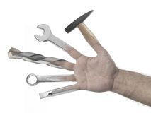 Handyman hand on a white background. Handyman hand hammer screwdriver wrenches drill on a white background Royalty Free Stock Image